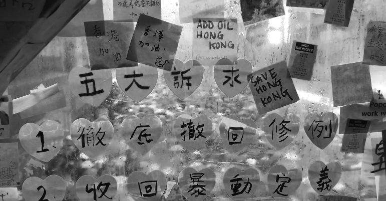 Post it notes in support for the hong kong protesters are stuck onto a glass wall