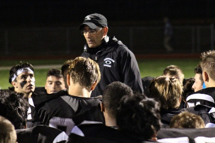 Coach St. George during an October 2018 football game, part of his last year as the LHS Varsity Football Coach. After 33 years as a LHS football coach and 20 years as a wellness teacher, Coach St. George is retiring starting the third quarter this year.